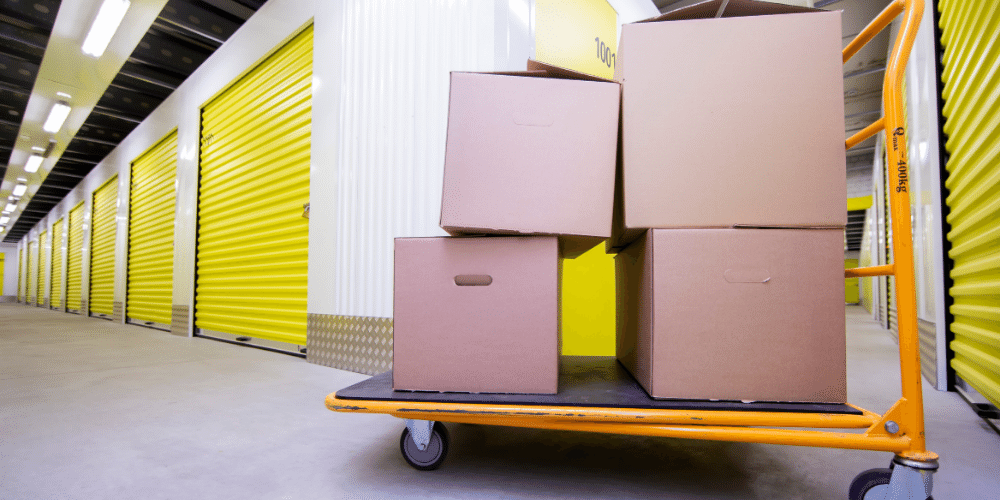 yellow self storage doors trolley with boxes